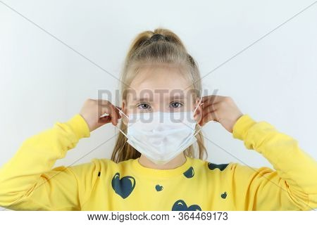 Glad And Happy Beautiful Joy,child Taking Medical Helthcare Guarding Or Protecting Mask And In Yello