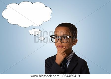 Concept Of Confusion, Inspiration And Solution- Pensive Little African American Boy In Business Suit