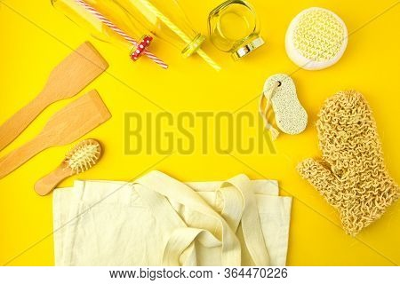 Zero Waste Concept. Textile Eco Bags, Glass Jars, Wooden Hair Brush And Washcloth On Yellow Backgrou