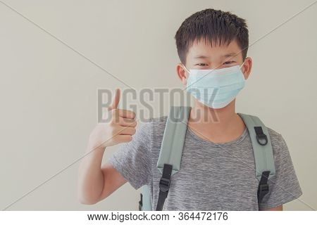 Asian Preteen Tween Boy Wearing Mask And Giving Thumb Up, School Reopening, Return Back To School Af