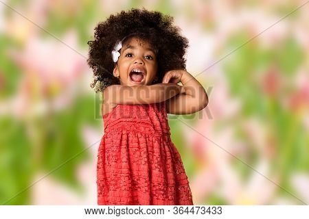 Childhood And People Concept-cheerful Happy African American Little Girl Over Blurred Background