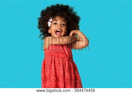 Portrait Of Cheerful Happy African American Little Girl Isolated Over Colored Background