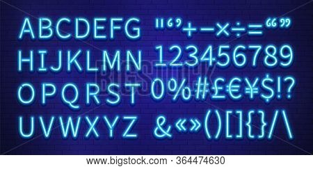 Neon Font. Blue Letters Numbers Marks On Brick Wall. Colorful Glow Typography, Futuristic Abc. Decor