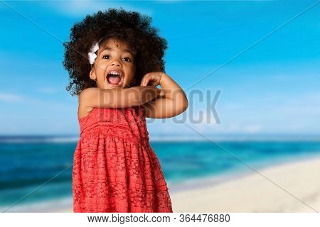 Childhood And People Concept-cheerful Happy African American Little Girl Over Blurred Nature Backgro