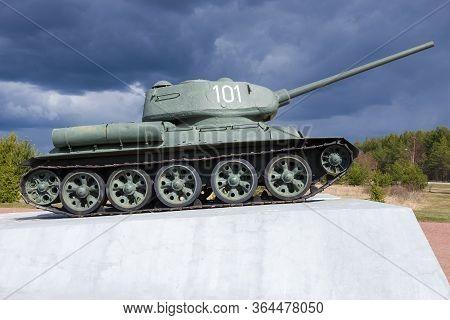 Kirovsk, Russia - April 26, 2020: Tank-monument T-34-85 On The Nevsky Patch Under A Stormy Sky In Ap