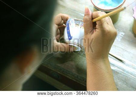 Artist Painting Benjarong Ceramic Ware