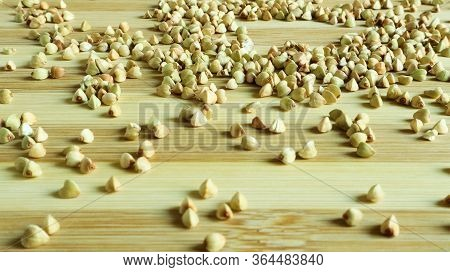 Green Buckwheat Seeds On A Wooden Background. Great Food. Healthy Groats. Organic Raw Non-fried Vege