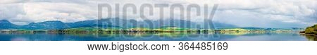 Panorama Of Lake In Mountains. Cloudy Day In Springtime. Beautiful Scenery Of High Tatra Mountains I