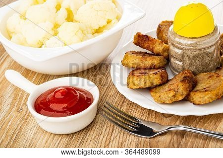 Boiled Cauliflower In White Bowl, Tomato Ketchup In Sauceboat With Handle, Small Chicken Cutlets And