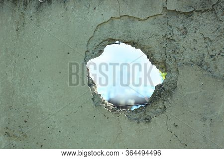 Old Concrete Fence With Hole On Blue Sky View. Wall With Broken Tiles, Use As Horror Scene, Backgrou