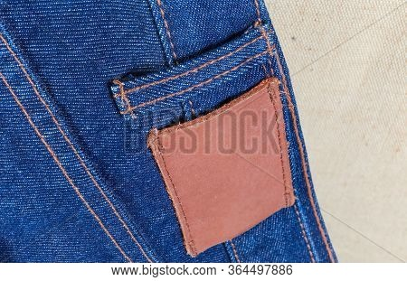 Blank Thick Leather Label Sewed On A Waistband On Back Of The Blue Jeans, Close-up