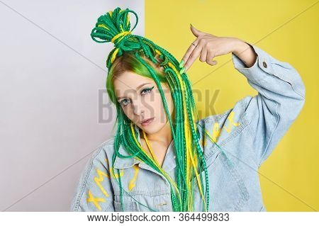 Portrait Of A Woman With Creatively Colored Hair In Green And Yellow Color. Colorful Bright Dreadloc