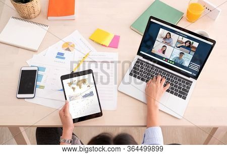Asian Woman Work From Home With Video Conference App Collaboration With Colleagues With Business Cha