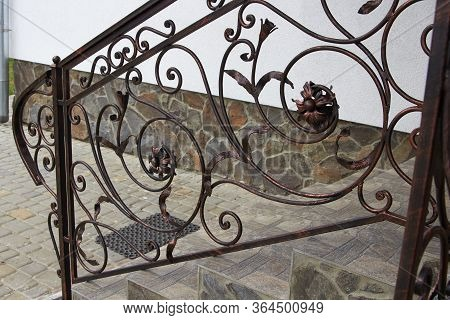 Metal Railing Forged, Stairs To The House With Metal Railings With Forged Parts