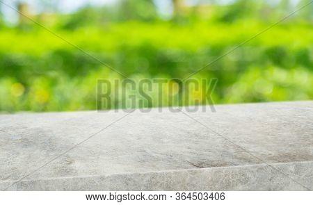 Spring Background.empty Diagonal Grunge Grey Concrete Table With Blur Tree In Garden Boekh Backgroun