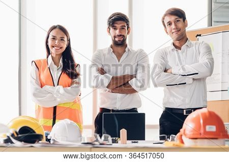 Group Of Engineer Young Asian And Caucasian Standing And Cross Arms After Meeting. Teamwork People E