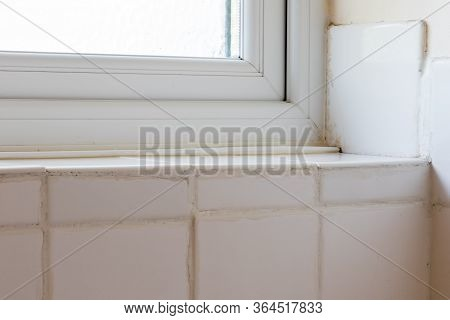 Diy Disaster. Bad Tiling Of Ceramic Bathroom Tiles. Terrible Fixing And Grouting Around A Window. Do