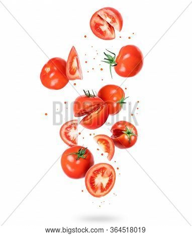 Whole And Sliced Fresh Tomatoes In The Air, Isolated On A White Background