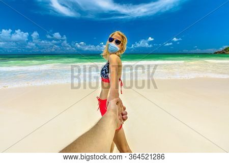 Beach Relax In Covid-19 Time: Tourist Woman Sunbathing Holding Hand Of Her Partner At Seychelles Bea