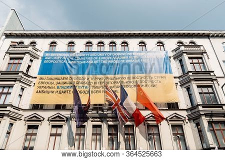 Berlin, Germany - July 29, 2019: Banner With Colors Of Ukraine Flag Calling On Putin To Respect Ukra
