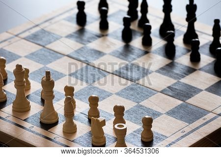 Cropped View Of Chess Board With Chess Pieces On Rustic Wooden Surface