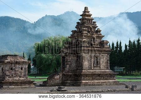 Candi Arjuna Ancient Hindu Temple, With Carvings And Granite Spires And Stupas In Arjuna Complex, Di