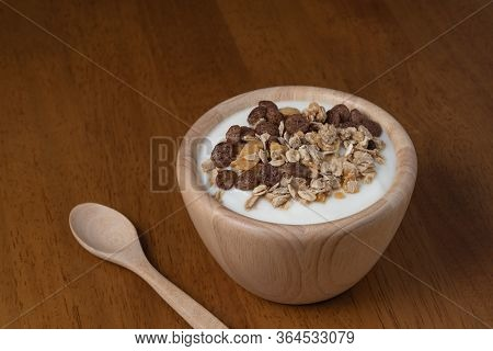 Natural Homemade Plain Organic Yogurt In Wooden Bowl And Wood Spoon On Wood Texture Background, Copy