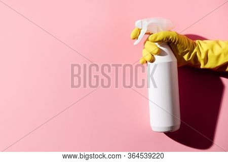Female hands cleaning on pink background. Cleaning or housekeeping concept background.