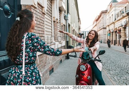 Two Happy Friends Meeting And Greeting In The Street