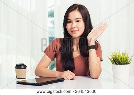 Work From Home, Asian Business Young Beautiful Woman Smiling Sitting On Desk Workspace Raise Hand Sa