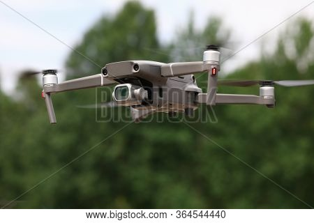 Close-up Of Drone Quadcopter With Digital Camera Flying In Air. Equipment Captures Video Footage. Ou