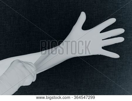 Hand In Latex Glove Protected From Damage And Infection