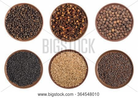 Set Of Spice In Clay Plates: Cloves, Black Pepper, Allspice, Mustard Seeds, Cumin (jeera) Isolated O