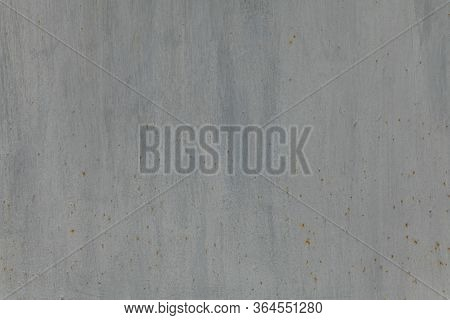 Metallic Wall Background, Texture. Grey Smooth Painted Surface With Vertical Strokes Of Paint And Ru
