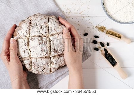 Hands Holding Brown Bread Loaf Fresh Baked Flatlay Photography. Girl Arms Hold Home Made Nourishment