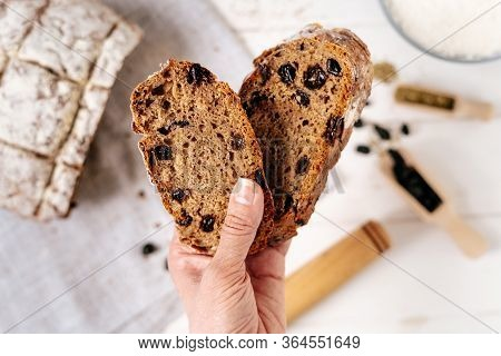 Bread Sliced Baked Pieces In Woman Hand Closeup Top View Photo. Natural Cooked Toasts Nourishment Wi