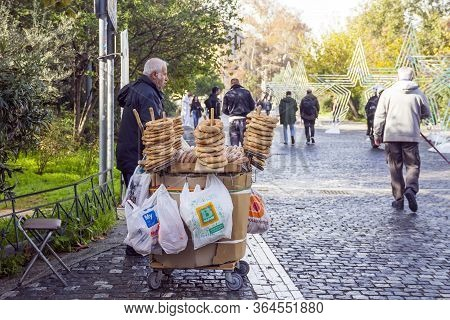 Athens, Greece - December 21, 2019: Man Selling Greek Sesame Bagel Koulouri On Dionysiou Areopagitou