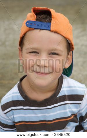 Beautiful Boy With Cap Smiling