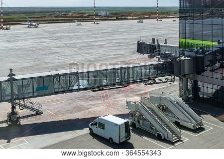 Simferopol, Russia - May 02, 2019: International Passenger Airport.  Airbridge Or Jetway Is On Backg