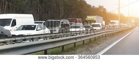 Highway Interstate Road With Car Traffic Jam And Tree Forest On Background. Motorway Bumber Barrier