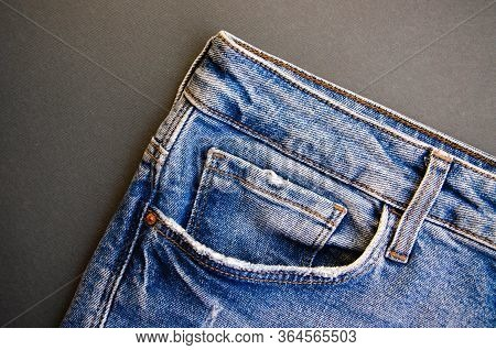 Jeans On A Black Background. Jeans Elements, Pockets, Seams In Close-up. Ripped Jeans. Copy Space