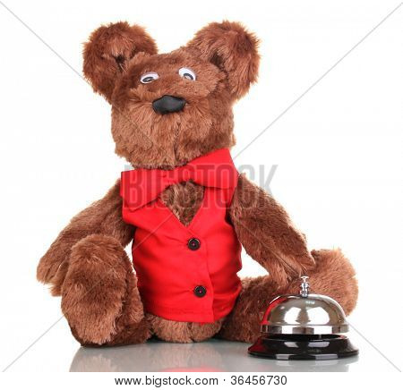Toy bear and bell isolated on white