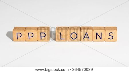 Ppp Loan Paycheck Protection Program Concept. Wooden Blocks With Text On White Background. Copy Spac