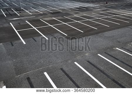 Parking lot with empty places, no cars