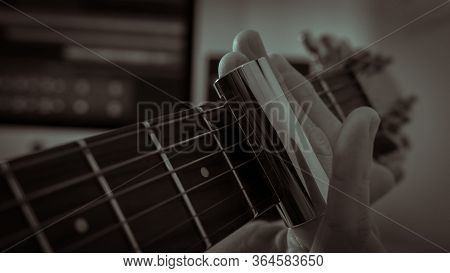 Man Playing An Acoustic Guitar With Slide