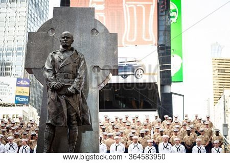 MAY 22 2019-NEW YORK: U.S. Sailors and Marines gather for a group photo on the iconic red steps  by the Father Duffy statue during Fleet Week in Manhattan on May 22, 2019.