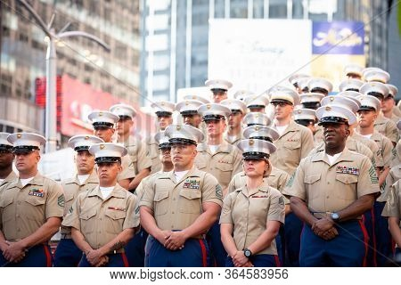 MAY 22 2019-NEW YORK: U.S. Marines gather for a group photo on the iconic red steps in Father Duffy Square during Fleet Week in Manhattan on May 22, 2019.