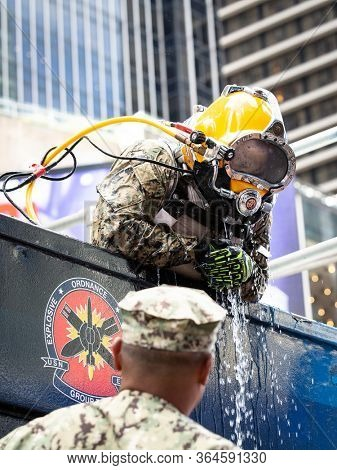 MAY 24 2019-NEW YORK: Underwater US Navy EOD technician emerges from the 6,800 gallon mobile dive tank at the Military Island Plaza in Times Square during Fleet Week on May 24, 2019.