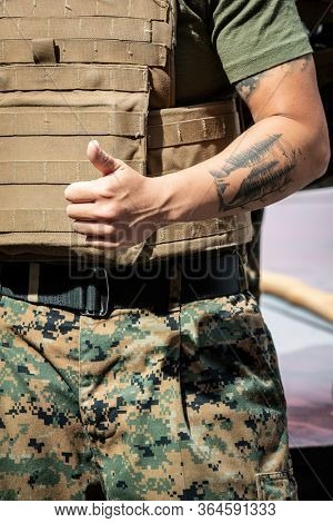 MAY 24 2019-NEW YORK: U.S. Marine gives a thumbs up at the Armed Forces Recruiting Station on Military Island Plaza in Times Square after a MCMAP demonstration during Fleet Week on May 24, 2019.