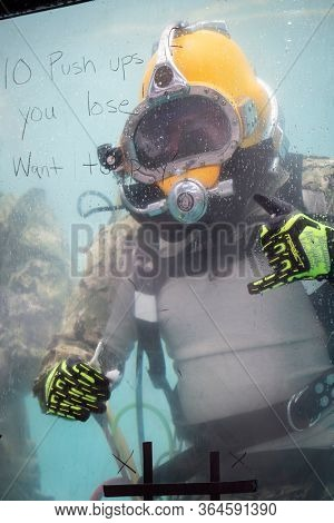 MAY 24 2019-NEW YORK: A US Navy EOD technician underwater in a 6,800 gallon mobile dive tank at the Military Island Plaza in Times Square during Fleet Week on May 24, 2019.